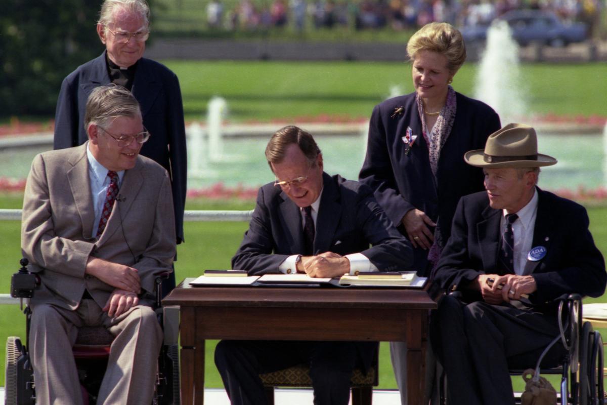 Bush signs the ADA into law